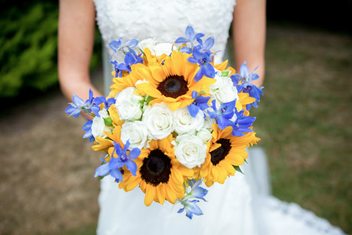 Sunflower and blue wedding bouquet form Boho weddings